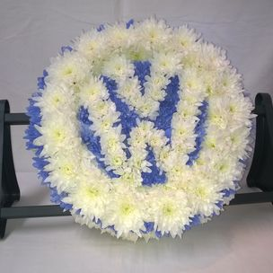 V W car badge in Blue & White flowers