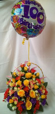 Birthday flowers .silk flowers in basket with balloon
